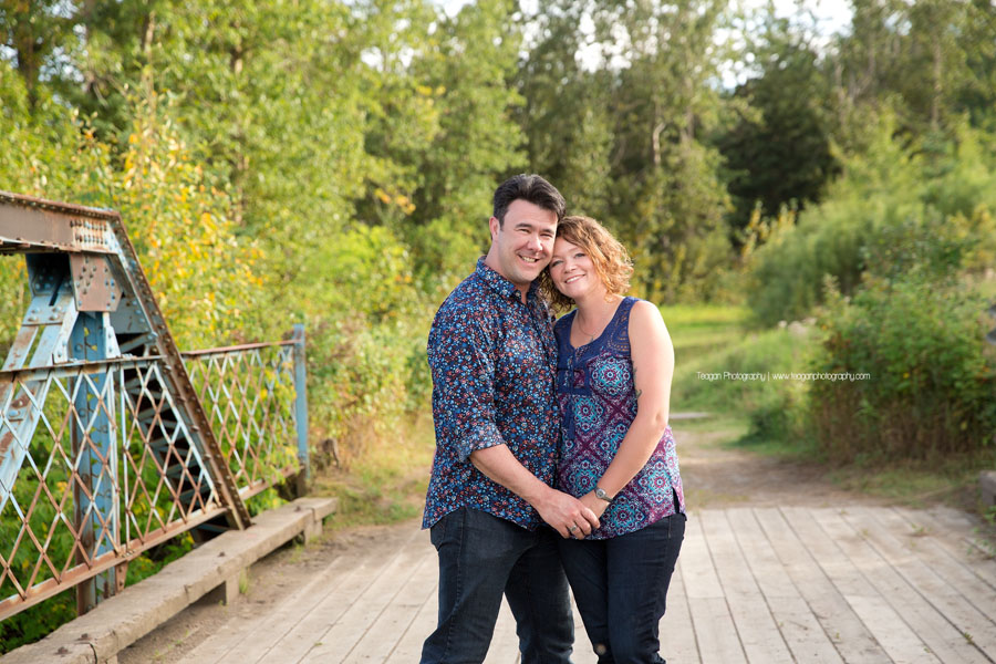 A couple cuddle together during an Edmonton photography session