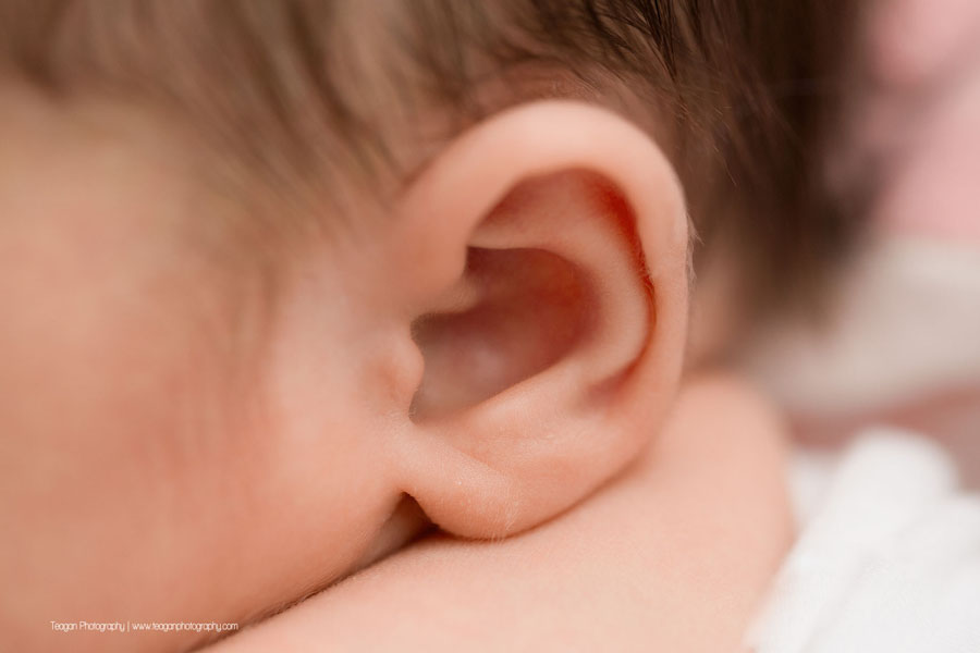 a close up of a newborn baby girl's ear in an Edmonton newborn photo session