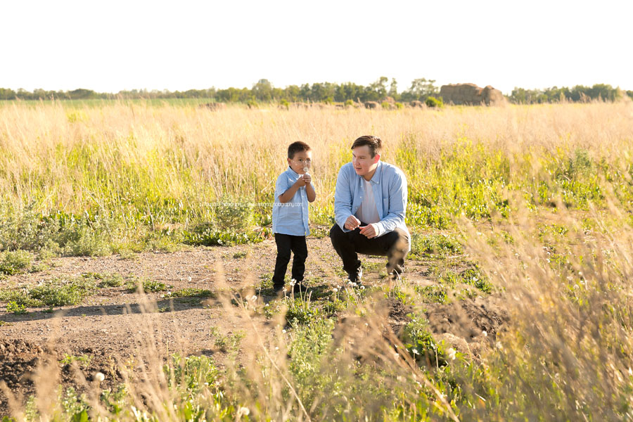 A dad and son play together in an Edmonton field