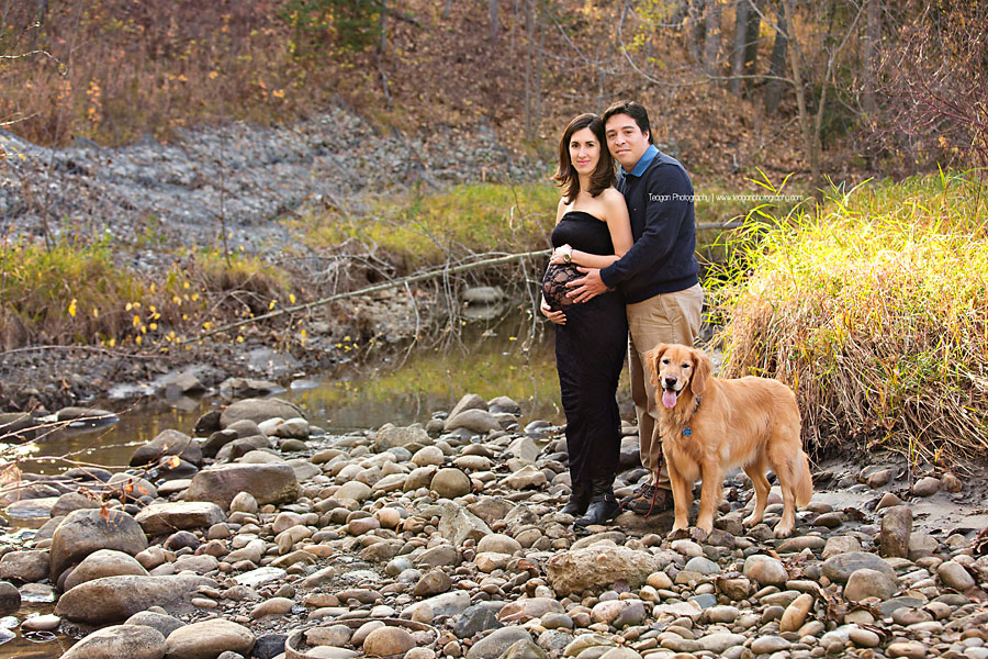 A pregnant couple poses together for photos in Edmonton's Millcreek Ravine