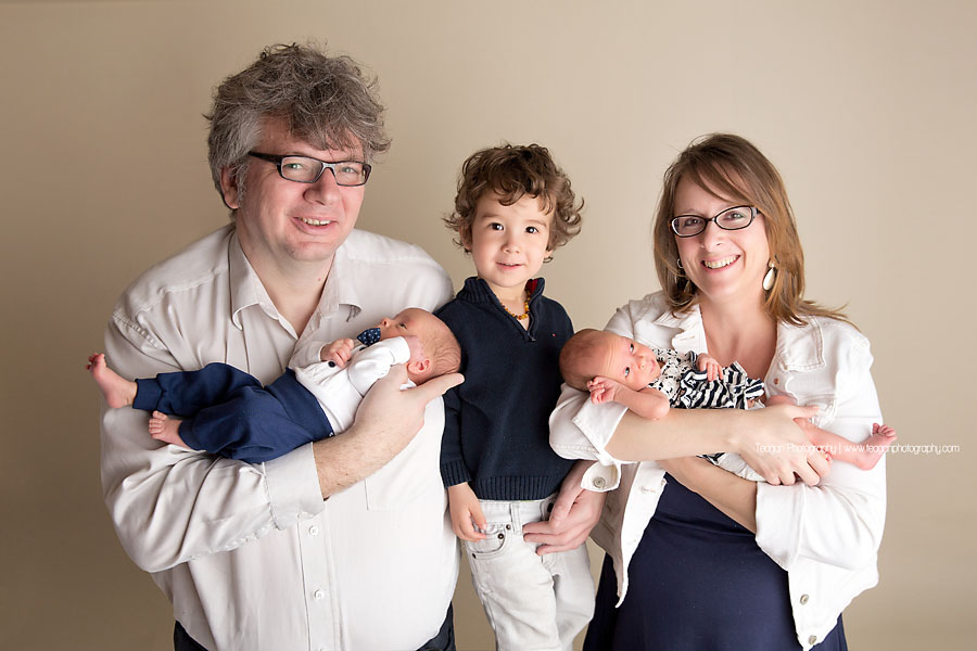A new Edmonton family pose together with their twin babies and  preschool age son