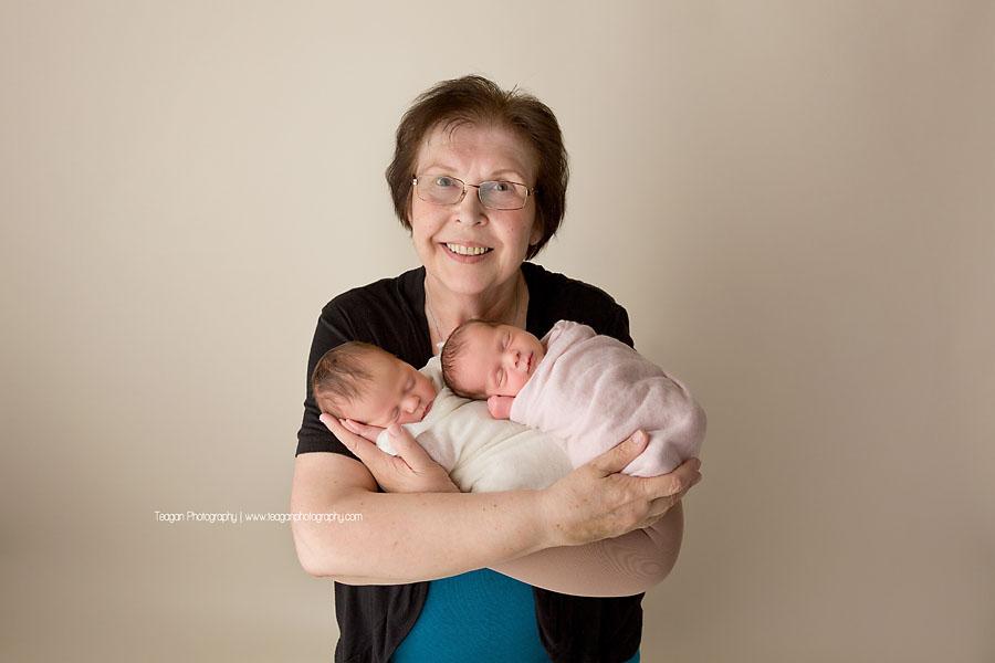 An Edmonton grandmother hugs her twin newborn granddaughters