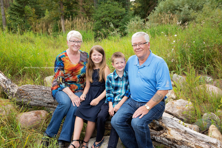 Grandparents sit with their two grandchildren