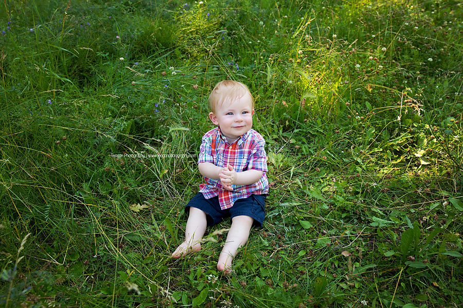 A cute one year boy celebarates his birthday with an outdoor photo shoot