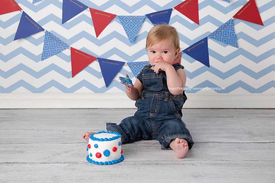 A one year boy celebrates his first birthday with a blue,white and red themed cake smash in Edmonton