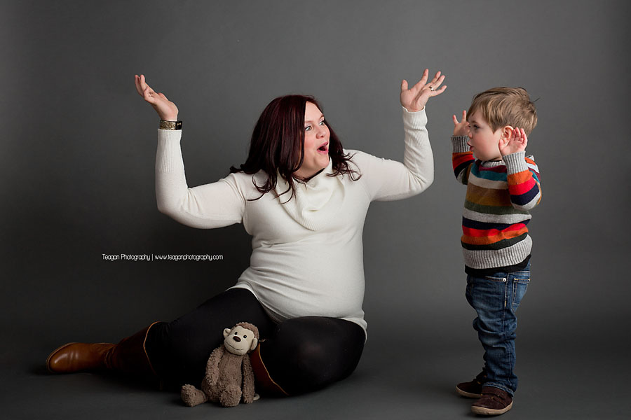 A mother poses with her little boy during maternity photos in Edmonton
