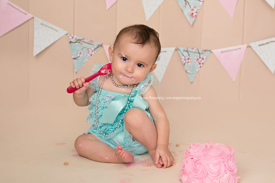 During an Edmonton cake smash photography session the birthday girl does not like her cake