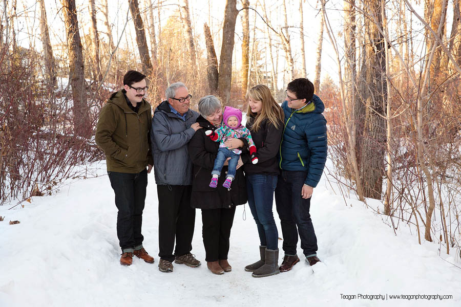 A large family poses together on a snowy path in St Albert