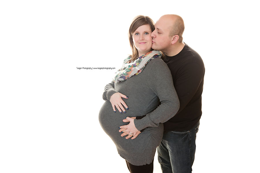 An Edmonton family snuggles together for maternity photos