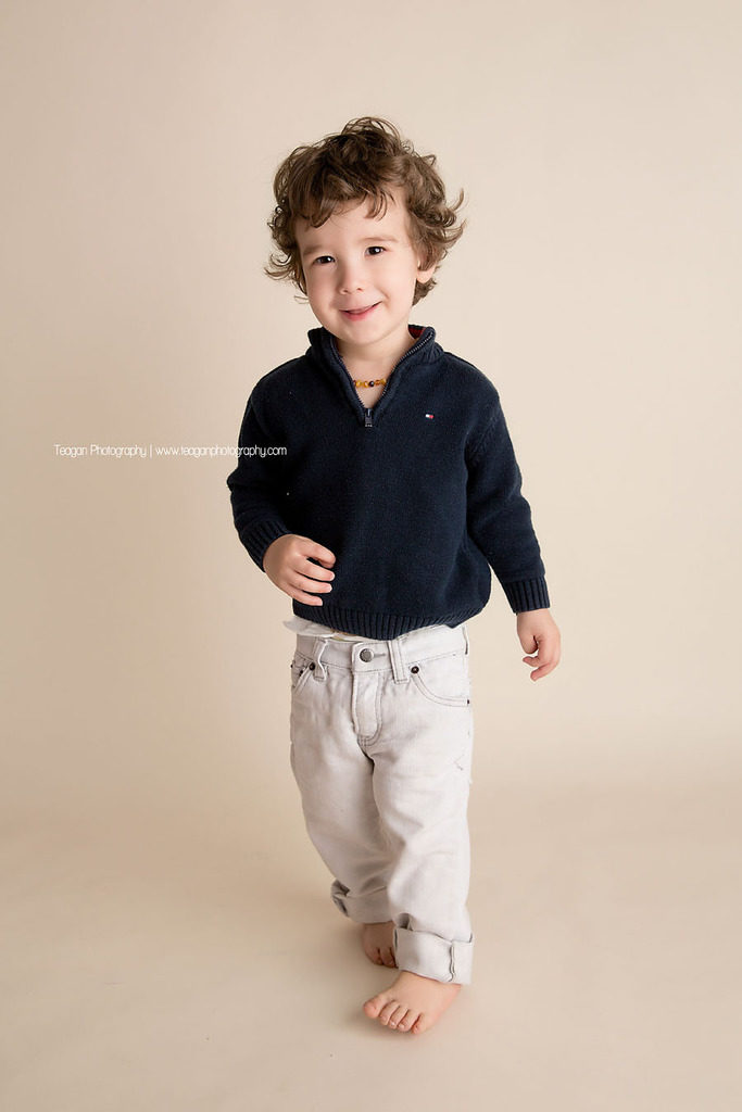 A toddler struts during a photoshoot