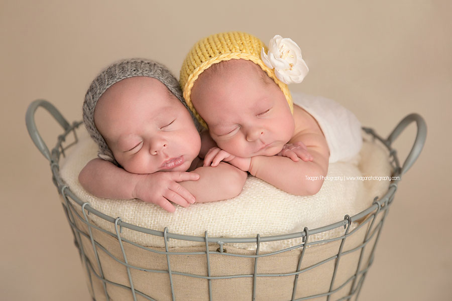 Twin babies  snuggle together during an  Edmonton newborn photography session