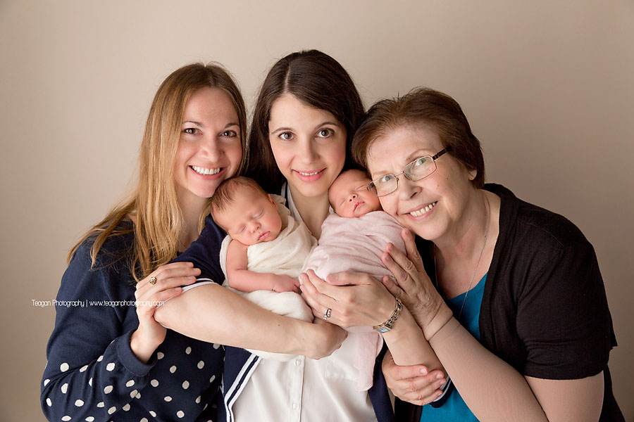 A generational photo with a grandma, her daughters and her newborn twin granddaughters in Edmonton