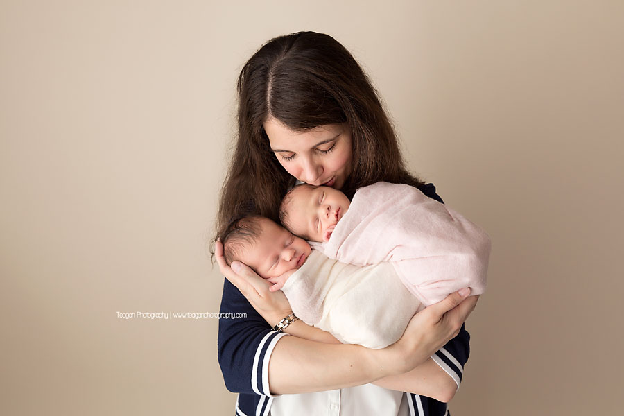 A new mother hugs her twin baby girls
