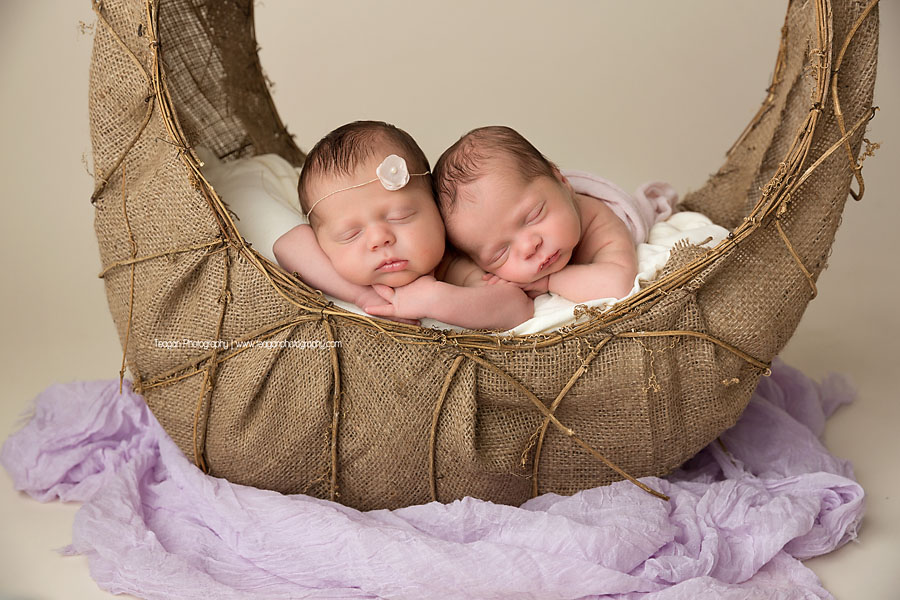 Baby twins sleep in a wicker basket during an Edmonton newborn photoshoot