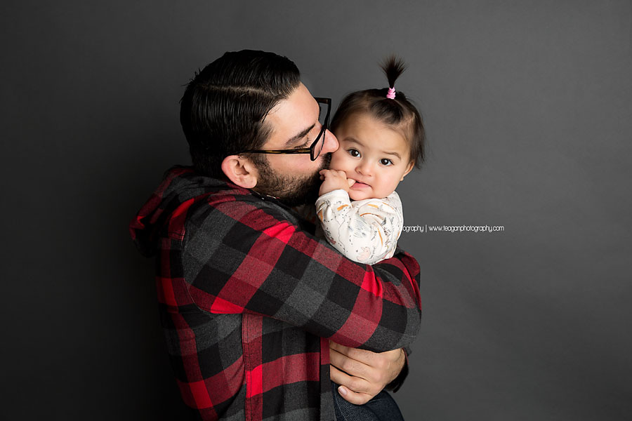 A middle eastern father kisses the cheek of his baby girl in Edmonton