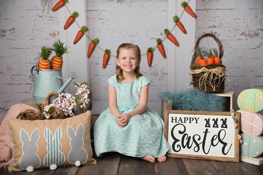 Edmonton Easter and Spring mini photography back drop with a cute blonde girl in a blue dress.