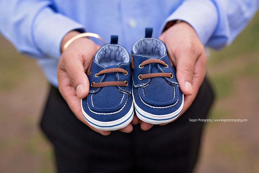 a close up on the little blue denim shoes for his unborn baby boy