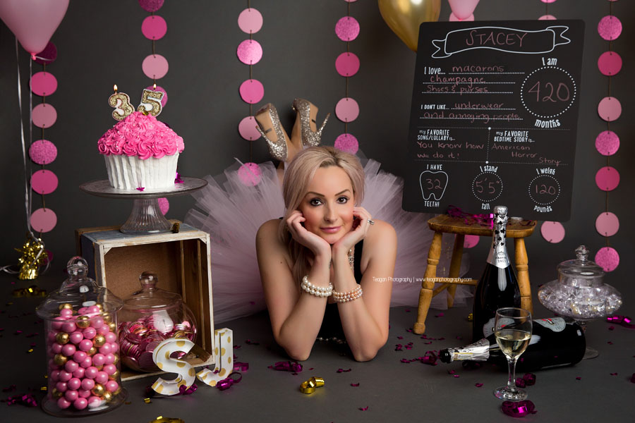 A blonde woman wears a pink tutu and sparkly Louboutin shoes for an adult cake smash in Edmonton